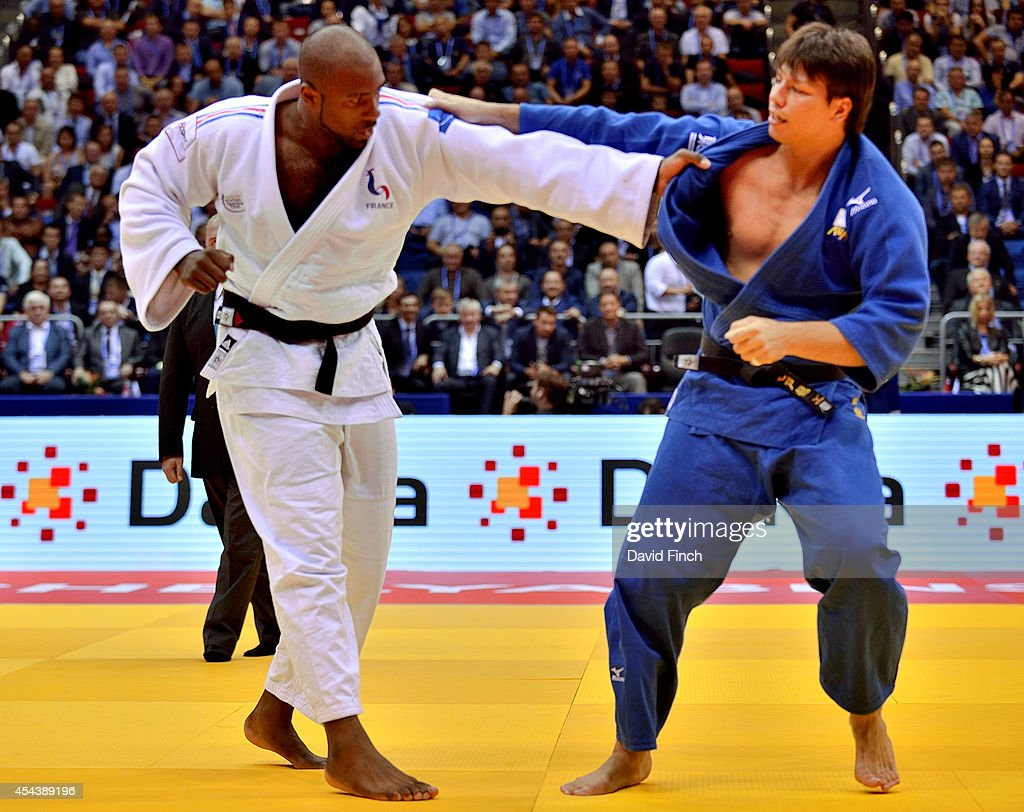Teddy Riner of France (white) defeated Ryu Shichinohe of Japan by 3 shidos to win the over 100kg gold medal during the Chelyabinsk Judo World Championships at the Sport Arena 'Traktor' on August 30, 2014 in Chelyabinsk, Russia.