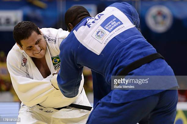 Teddy Riner of France fights against Rafael Silva of Brazil in final the 100 kg category during a World Judo Championships at Gymnasium Maracanazinho...