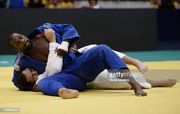 Teddy Riner of France fights against Rafael Silva of Brazil in the 100 kg final category during a World Judo Championships at Gymnasium Maracanazinho...