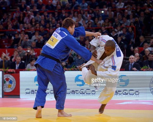 Teddy Riner of France stumbles in response to an attack by SungMin Kim of Korea before Riner used his favourite technique to score an ippon to win...