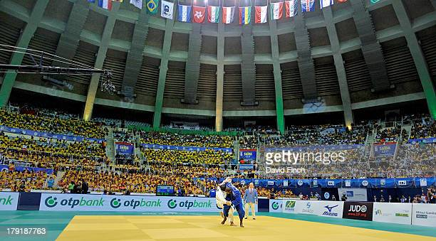 Teddy Riner of France throws Rafael Silva of Brazil for a wazari and then holds him to win his sixth World gold medal at the Rio World Judo...