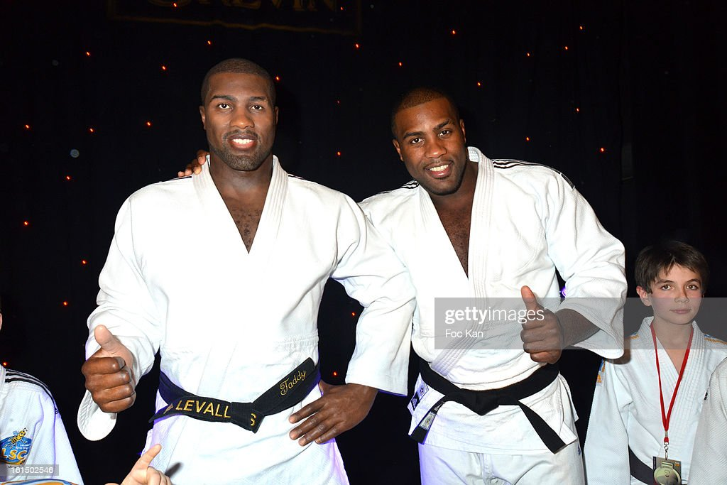 Teddy Riner (R) poses with his wax work during the Teddy Riner Waxwork Unveiling At Musee Grevin on February 11, 2013 in Paris, France.