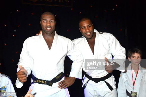 Teddy Riner poses with his wax work during the Teddy Riner Waxwork Unveiling At Musee Grevin on February 11 2013 in Paris France