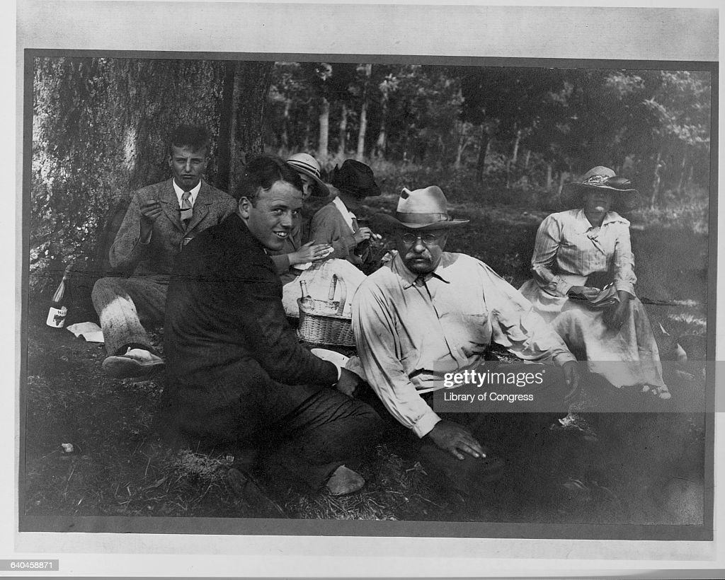 Teddy Roosevelt relaxes on a picnic with his family.