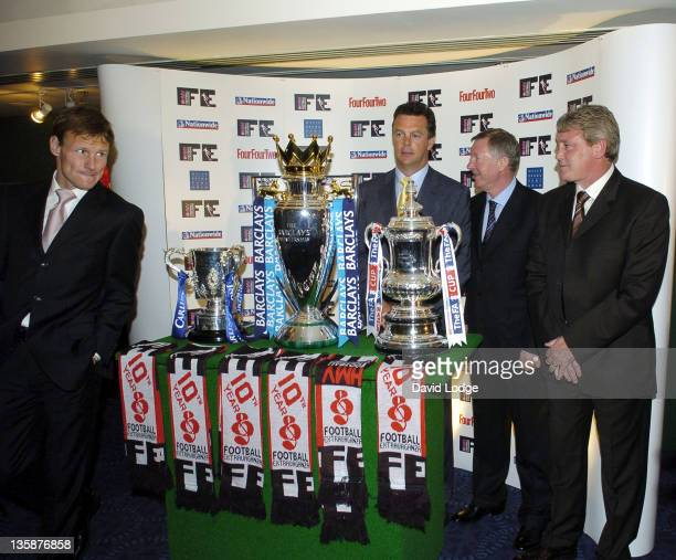 Teddy Sheringham David O'Leary Sir Alex Ferguson and Steve Bruce with The League Cup The Premiership Trophy and The FA Cup