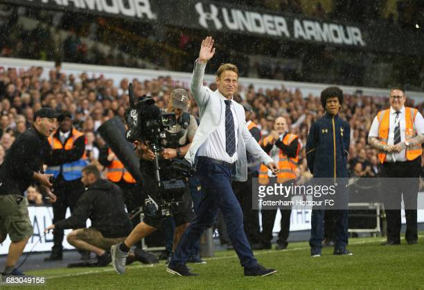 Teddy Sheringham ex Tottenham Hotspur player walks onto the pitch during the closing ceremony after the Premier League match between Tottenham...