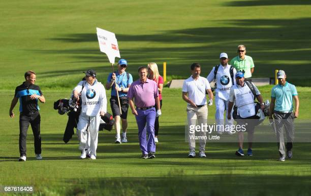 Teddy Sheringham Matt LeTissier Tim Sherwood and Martin Kaymer of Germany walk down the fairway with their caddies during the BMW PGA Championship...