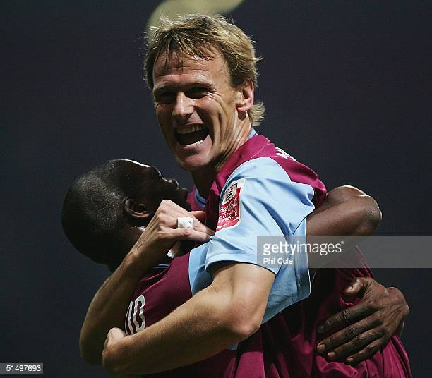 Teddy Sheringham of West Ham celabrates scoring with Marlon Harewood during the CocaCola Championship match between West Ham United and Stoke City at...