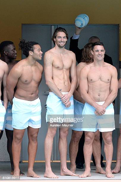 Teddy Thomas Camille Lacourt and Dan Carter pose before the swimming training session at Piscine Molitor on February 17 2016 in Paris France