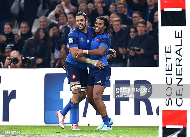 Teddy Thomas of France celebrates scoring his 3rd try with team mate Damien Chouly during the friendly match between France and Fiji on November 8...