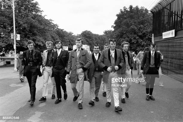 Teddyboys arrive for the Rock revival festival wearing long jackets drainpipe trousers and string ties