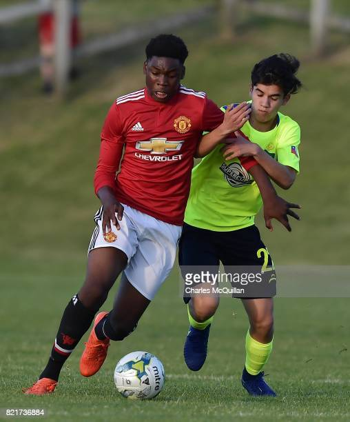 Teden Mengi of Manchester United and Dylan Oklguin of Colina during the NI Super Cup junior section game between Manchester United and Colina at...