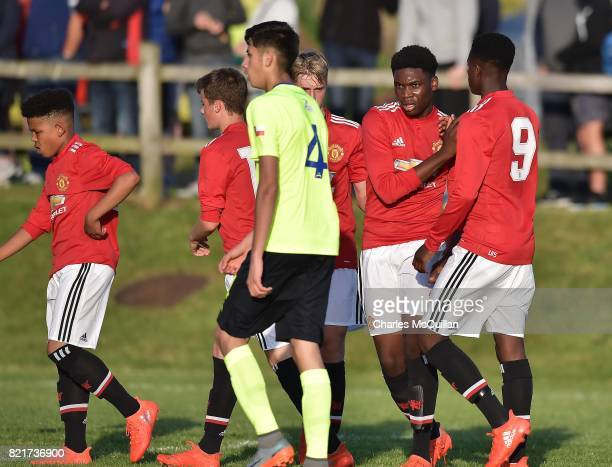 Teden Mengi of Manchester United celebrates after scoring during the NI Super Cup junior section game between Manchester United and Colina at...