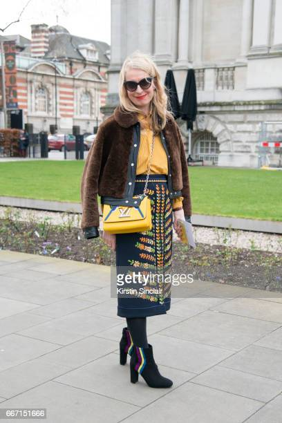 'tEditor in Chief of Red Magazine Sarah Bailey wears a Boden skirt Louis Vuitton bag Sandro jacket LK Bennett shoes and Balenciaga sunglasses on day...