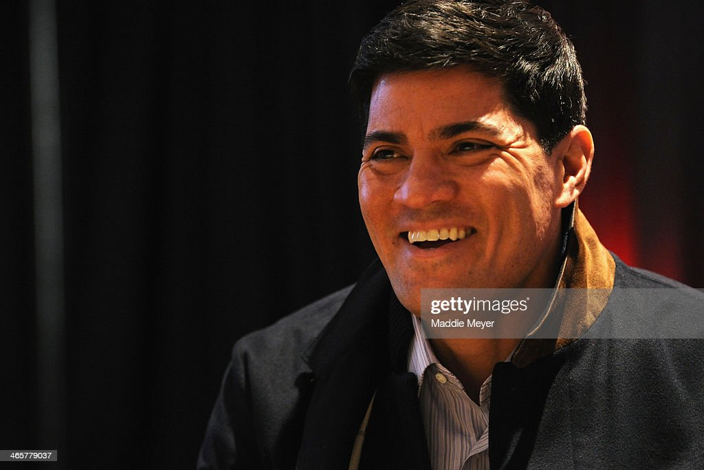 Tedy Bruschi, former NFL player, and current ESPN analyst, talks with reporters during the ESPN media availablility in the Empire West Ballroom, at Super Bowl XLVIII Media Center at the Sheraton New York Times Square on January 28, 2014 in New York, New York.