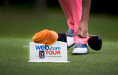 A tee box marker is used as support for a club on the six hole during the third round of the Webcom Tour LECOM Health Challenge at Peek'n Peak Rst...