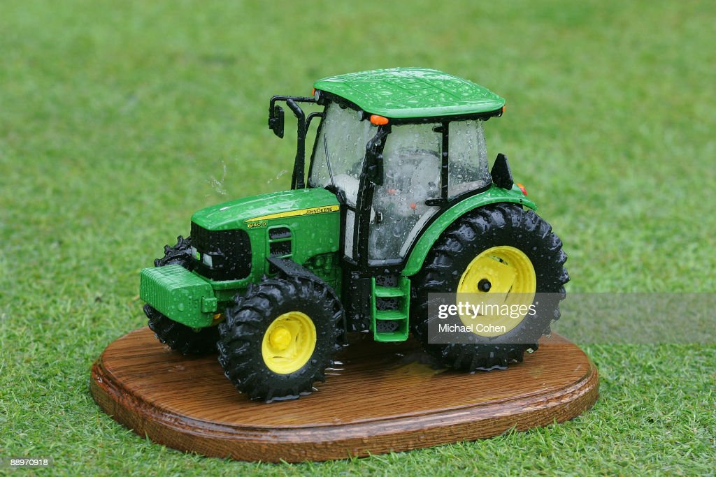 A tee marker reflects conditions as storms cause the suspension of play during the second round of the John Deere Classic at TPC Deere Run held on...