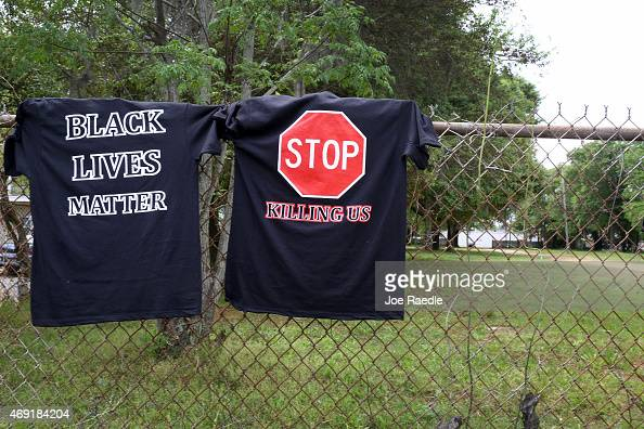 A tee shirt reading 'Stop Killing Us' and 'Black Lives Matter' are seen on a fence near the spot where Walter Scott was killed on April 4th by a...