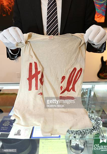 A tee shirt worn by Keith Richards on stage during The Rolling Stones' 1981 American tour with the world 'Hell' printed in red and intentionally...