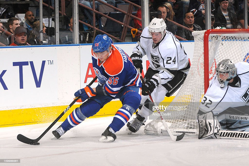 <a gi-track='captionPersonalityLinkClicked' href=/galleries/search?phrase=Teemu+Hartikainen&family=editorial&specificpeople=5485386 ng-click='$event.stopPropagation()'>Teemu Hartikainen</a> #56 of the Edmonton Oilers battles for position behind the net against <a gi-track='captionPersonalityLinkClicked' href=/galleries/search?phrase=Colin+Fraser&family=editorial&specificpeople=2225768 ng-click='$event.stopPropagation()'>Colin Fraser</a> #24 of the Los Angeles Kings at Rexall Place on January 24, 2013 in Edmonton, Alberta, Canada.