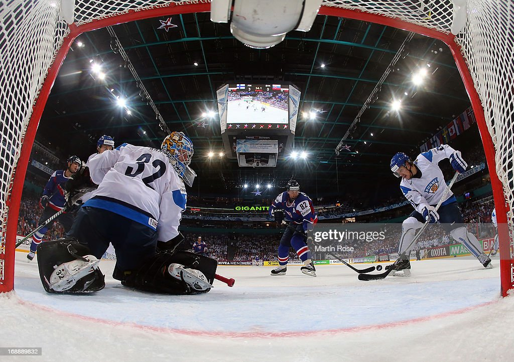 Teemu Laakso (R) of Finland and Tomas Kopecky(C) of Slovakia battle for the puck during the IIHF World Championship quarterfinal match between Finland and Slovakia at Hartwall Areena on May 16, 2013 in Helsinki, Finland.