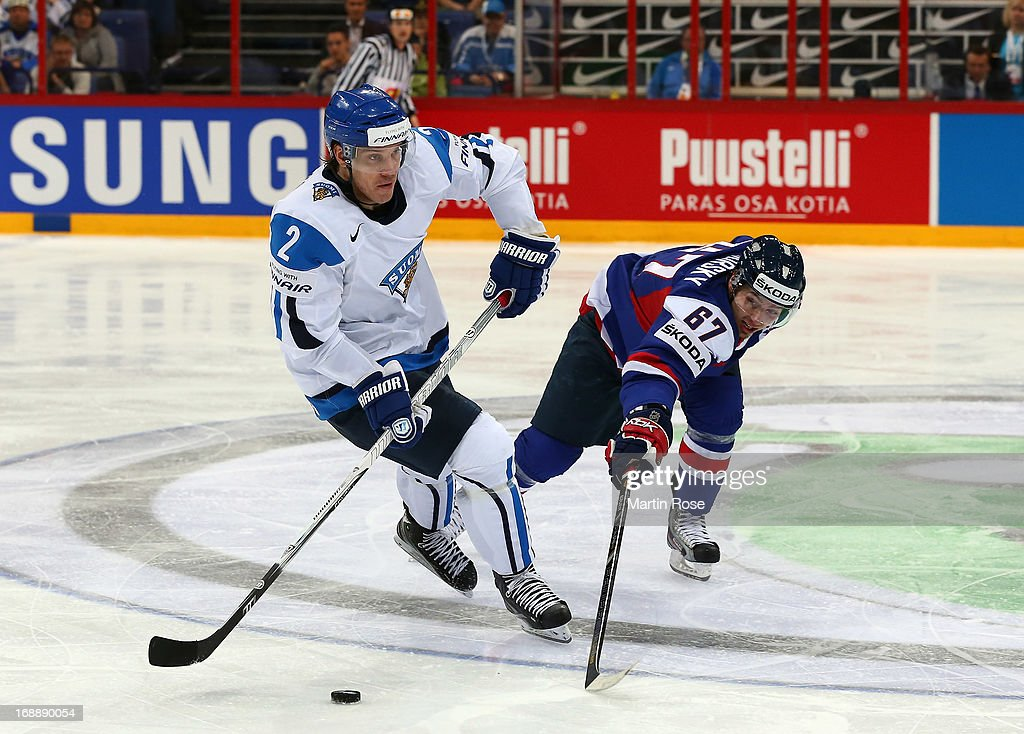 Teemu Laakso (L) of Finland and Tomas Zaborsky(R) of Slovakia battle for the puck during the IIHF World Championship quarterfinal match between Finland and Slovakia at Hartwall Areena on May 16, 2013 in Helsinki, Finland.