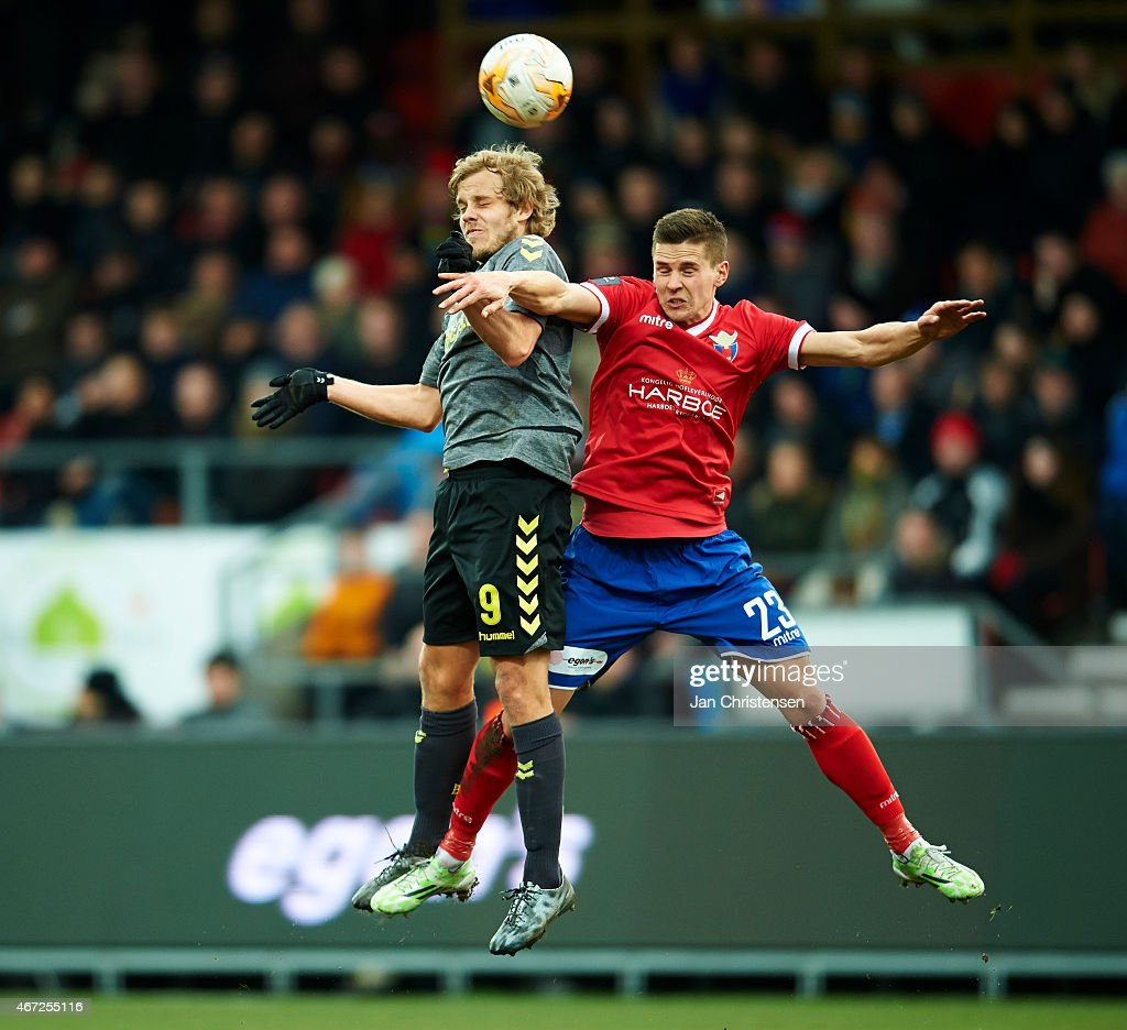 <a gi-track='captionPersonalityLinkClicked' href=/galleries/search?phrase=Teemu+Pukki&family=editorial&specificpeople=8055578 ng-click='$event.stopPropagation()'>Teemu Pukki</a> of Brondby IF (L) and Jukka Raitala of FC Vestsjalland tries with a header during the Danish Alka Superliga match between FC Vestsjalland and Brondby IF at Harboe Arena Slagelse on March 22, 2015 in Slagelse, Denmark.