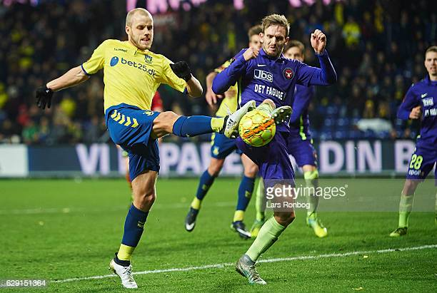 Teemu Pukki of Brondby IF and Kian Hansen of FC Midtjylland compete for the ball during the Danish Alka Superliga match between Brondby IF and FC...