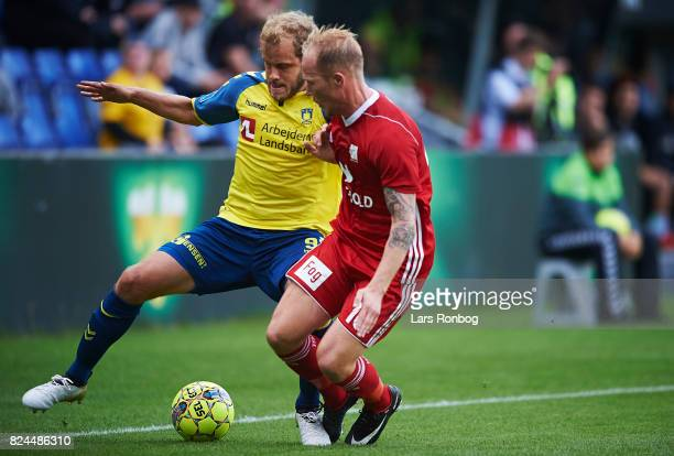 Teemu Pukki of Brondby IF and Mikkel Rygaard of Lyngby BK compete for the ball during the Danish Alka Superliga match between Brondby IF and Lyngby...
