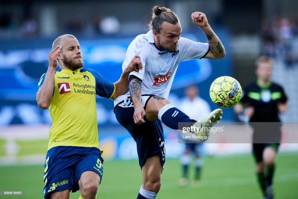Teemu Pukki of Brondby IF and Pierre Kanstrup of AGF Aarhus compete for the ball during the Danish Alka Superliga match between AGF Aarhus and Brondby IF at Ceres Park on August 20, 2017 in Aarhus, Denmark.