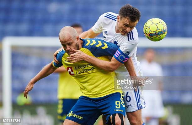 Teemu Pukki of Brondby IF and William Kvist of FC Copenhagen compete for the ball during the Danish Alka Superliga match between Brondby IF and FC...