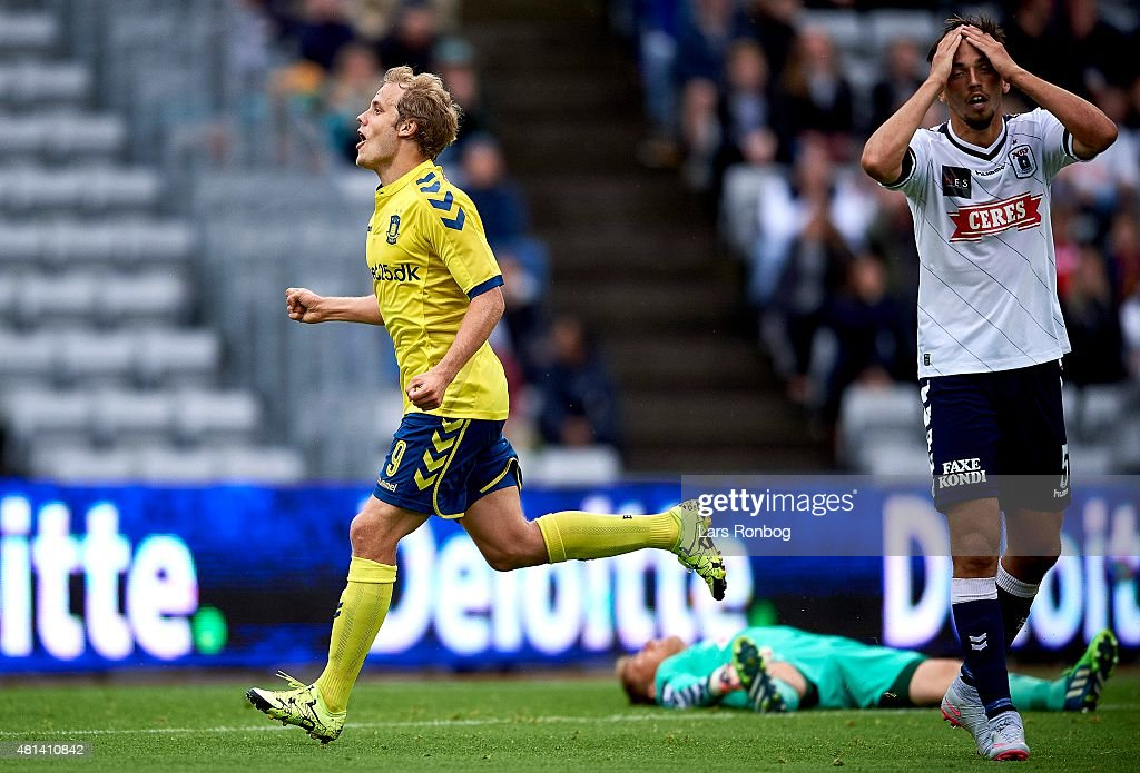<a gi-track='captionPersonalityLinkClicked' href=/galleries/search?phrase=Teemu+Pukki&family=editorial&specificpeople=8055578 ng-click='$event.stopPropagation()'>Teemu Pukki</a> of Brondby IF celebrates after scoring their first goal meanwhile Alexander Juel Andersen of AGF Aarhus looks dejected during the Danish Alka Superliga match between AGF Aarhus and Brondby IF at Cere Park on July 19, 2015 in Aarhus, Denmark.