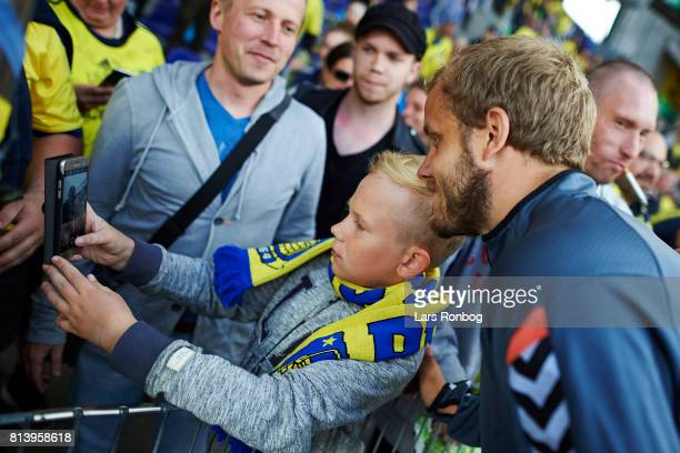 Teemu Pukki of Brondby IF haven a selfie taken with a young fan after the UEFA Europa League Qualification match between Brondby IF and VPS Vaasa at...