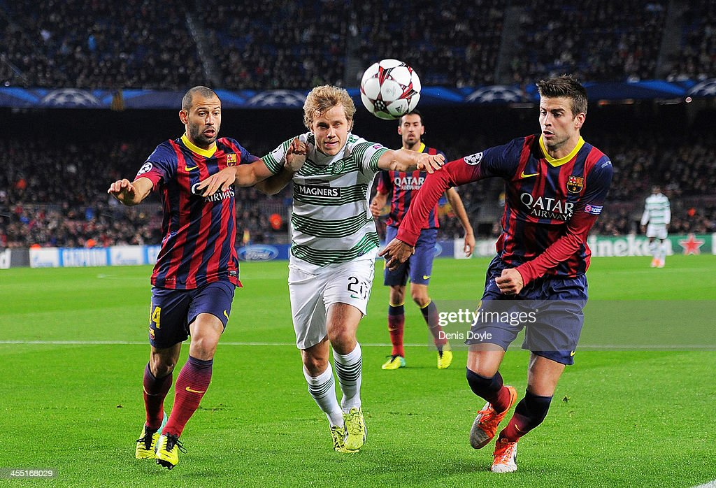 <a gi-track='captionPersonalityLinkClicked' href=/galleries/search?phrase=Teemu+Pukki&family=editorial&specificpeople=8055578 ng-click='$event.stopPropagation()'>Teemu Pukki</a> (C) of Celtic FC gets between <a gi-track='captionPersonalityLinkClicked' href=/galleries/search?phrase=Gerard+Pique&family=editorial&specificpeople=227191 ng-click='$event.stopPropagation()'>Gerard Pique</a> (R) and <a gi-track='captionPersonalityLinkClicked' href=/galleries/search?phrase=Javier+Mascherano&family=editorial&specificpeople=490876 ng-click='$event.stopPropagation()'>Javier Mascherano</a> of FC Barcelona battles for the ball against during the UEFA Champions League, Group H match between FC Barcelona and Celtic FC at the Camp Nou Stadium on December 11, 2013 in Barcelona, Spain.