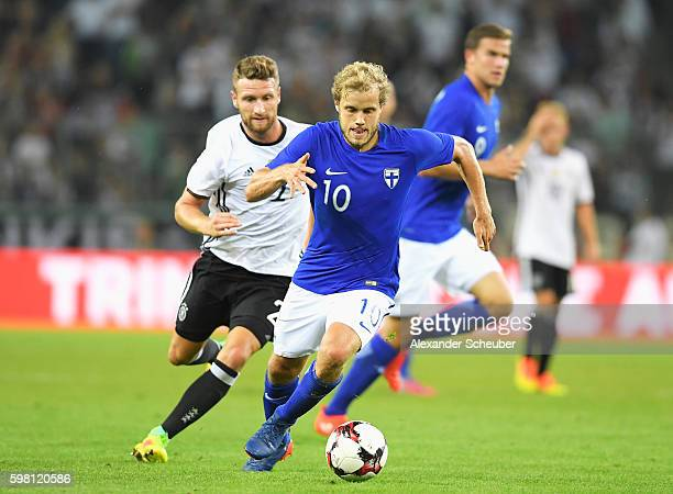 Teemu Pukki of Finland is closed down by Shkodran Mustafi of Germany during the International Friendly match between Germany and Finland at...