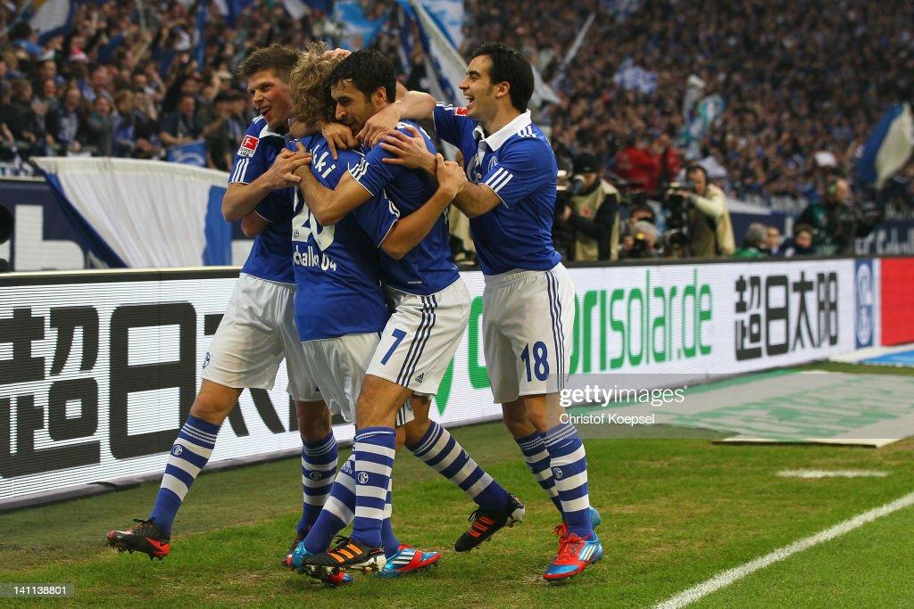 Teemu Pukki of Schalke celebrates the first goal with KlaasJan Huntelaar Raul Gonzalez and Jose Manuel Jurado of Schalke during the Bundesliga match...