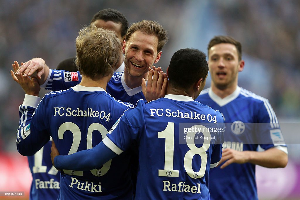 Teemu Pukki of Schalke celebrates the third goal with Benedikt Hoewedes, Raffael and Marco Hoeger during the Bundesliga match between FC Schalke 04 and TSG 1899 Hoffenheim at Veltins-Arena on March 30, 2013 in Gelsenkirchen, Germany.