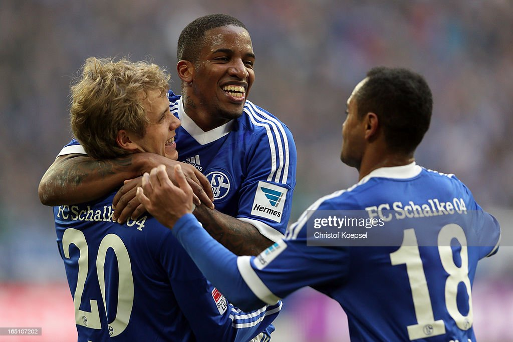 Teemu Pukki of Schalke celebrates the third goal with <a gi-track='captionPersonalityLinkClicked' href=/galleries/search?phrase=Jefferson+Farfan&family=editorial&specificpeople=791155 ng-click='$event.stopPropagation()'>Jefferson Farfan</a> and Raffael during the Bundesliga match between FC Schalke 04 and TSG 1899 Hoffenheim at Veltins-Arena on March 30, 2013 in Gelsenkirchen, Germany.