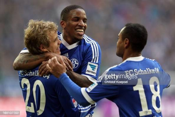 Teemu Pukki of Schalke celebrates the third goal with Jefferson Farfan and Raffael during the Bundesliga match between FC Schalke 04 and TSG 1899...