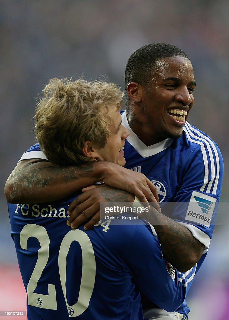 Teemu Pukki of Schalke celebrates the third goal with <a gi-track='captionPersonalityLinkClicked' href=/galleries/search?phrase=Jefferson+Farfan&family=editorial&specificpeople=791155 ng-click='$event.stopPropagation()'>Jefferson Farfan</a> during the Bundesliga match between FC Schalke 04 and TSG 1899 Hoffenheim at Veltins-Arena on March 30, 2013 in Gelsenkirchen, Germany.