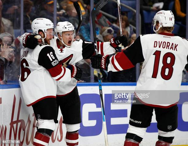 Teemu Pulkkinen of the Arizona Coyotes celebrates his goal against the Buffalo Sabres with Max Domi and Christian Dvorak during the first period at...