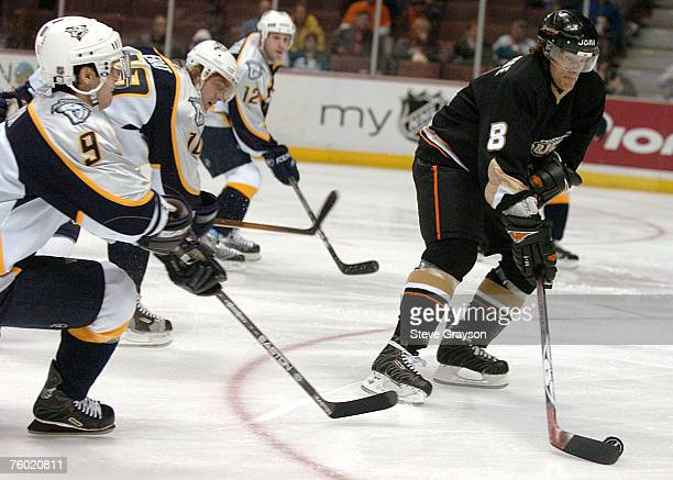 Teemu Salanne of the Anaheim Ducks moves the puck up ice as he is defended by Paul Kariya Martin Ereat and Scott NIchol of the Nashville Predators...