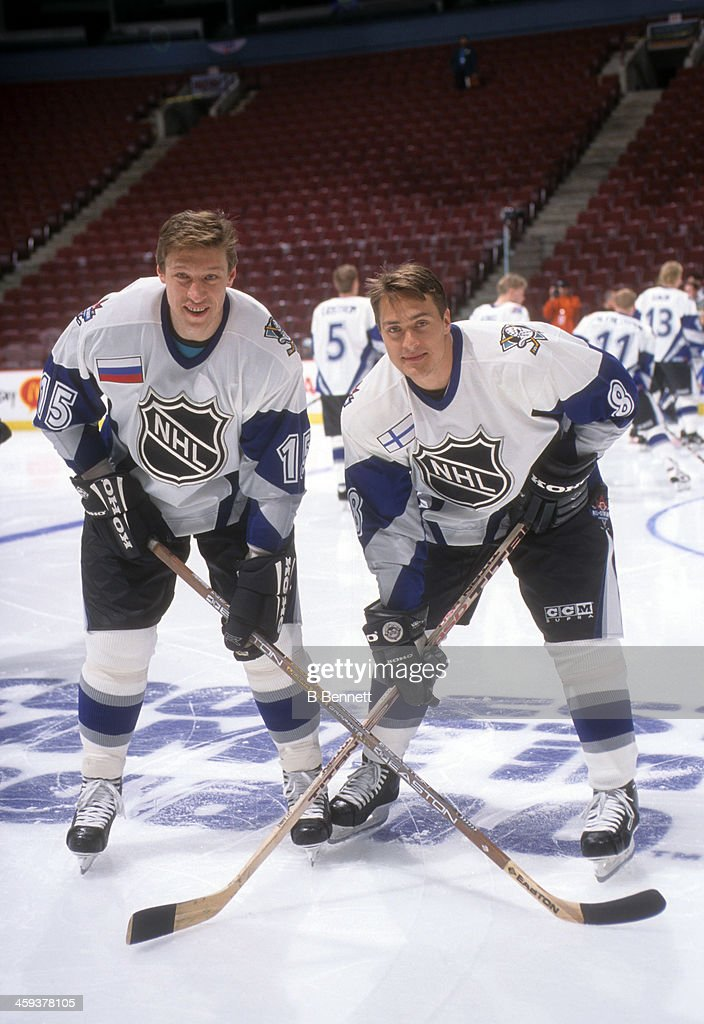 Teemu Selanne #8 and Dmitri Mironov of the World and Mighty Ducks of Anaheim pose for a portrait before the 1998 48th NHL All-Star Game against North America on January 18, 1998 at the General Motors Place in Vacouver, British Columbia, Canada.