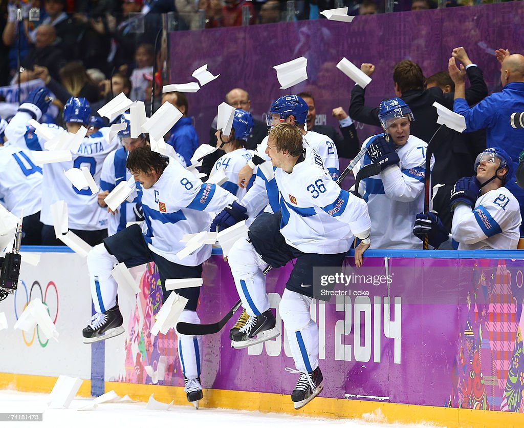Teemu Selanne #8 and Jussi Jokinen #36 of Finland celebrate with teammates after defeating the United States 5-0 during the Men's Ice Hockey Bronze Medal Game on Day 15 of the 2014 Sochi Winter Olympics at Bolshoy Ice Dome on February 22, 2014 in Sochi, Russia.