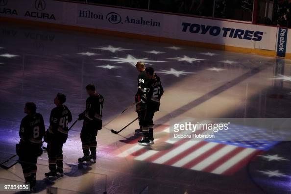 Teemu Selanne Dan Sexton Saku Koivu Scott Niedermayer and James Wisniewski of the Anaheim Ducks stand for the National Anthem before the game against...
