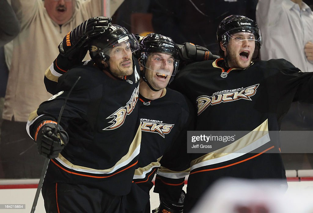 Teemu Selanne #8, Francois Beauchemin #23 and Bobby Ryan #9 of the Anaheim Ducks celebrate Selanne's go-ahead goal against the Chicago Blackhawks in the third period at Honda Center on March 20, 2013 in Anaheim, California. The Ducks defeated the Blackhawks 4-2.