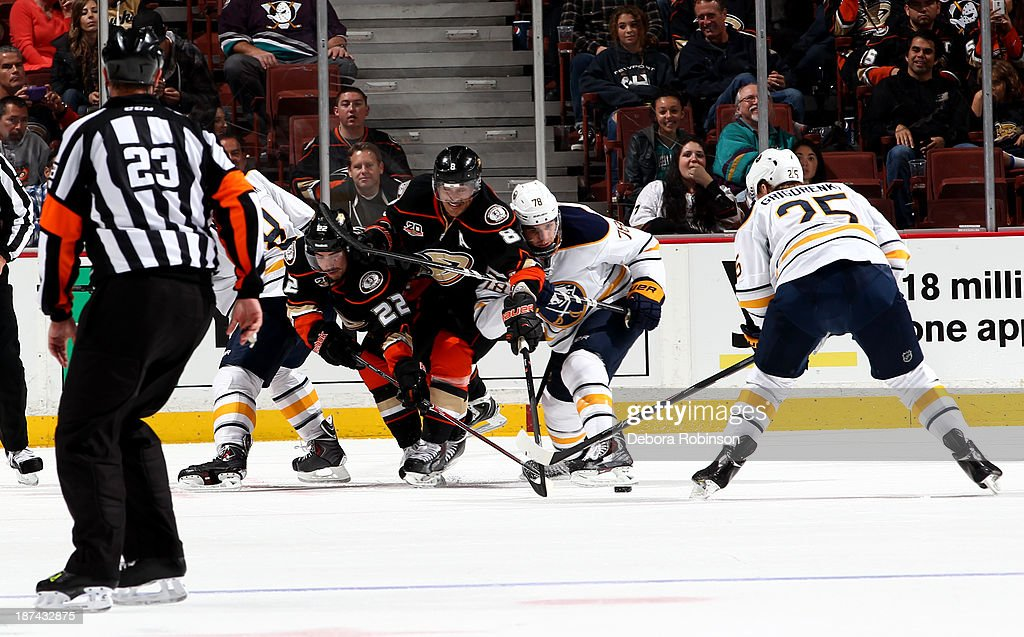 Teemu Selanne #8 of the Anaheim Ducks and <a gi-track='captionPersonalityLinkClicked' href=/galleries/search?phrase=Corey+Tropp&family=editorial&specificpeople=5483748 ng-click='$event.stopPropagation()'>Corey Tropp</a> #78 of the Buffalo Sabres fight for procession of the puck during a game at Honda Center on November 8, 2013 in Anaheim, California.