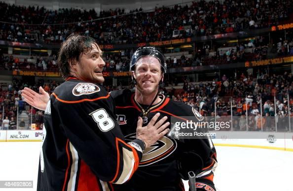 Teemu Selanne of the Anaheim Ducks and Saku Koivu celebrated Selanne's last regular season game in the NHLagainst the Colorado Avalanche on April 13...