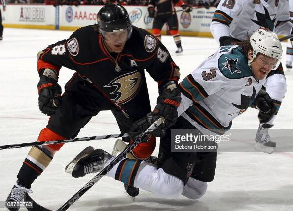 Teemu Selanne of the Anaheim Ducks battles for position against Douglas Murray of the San Jose Sharks during the game on February 3 2011 at Honda...