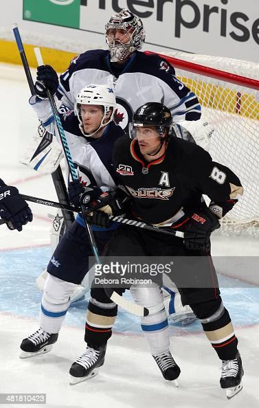 Teemu Selanne of the Anaheim Ducks battles for position against Tobias Enstrom of the Winnipeg Jets on March 31 2014 at Honda Center in Anaheim...